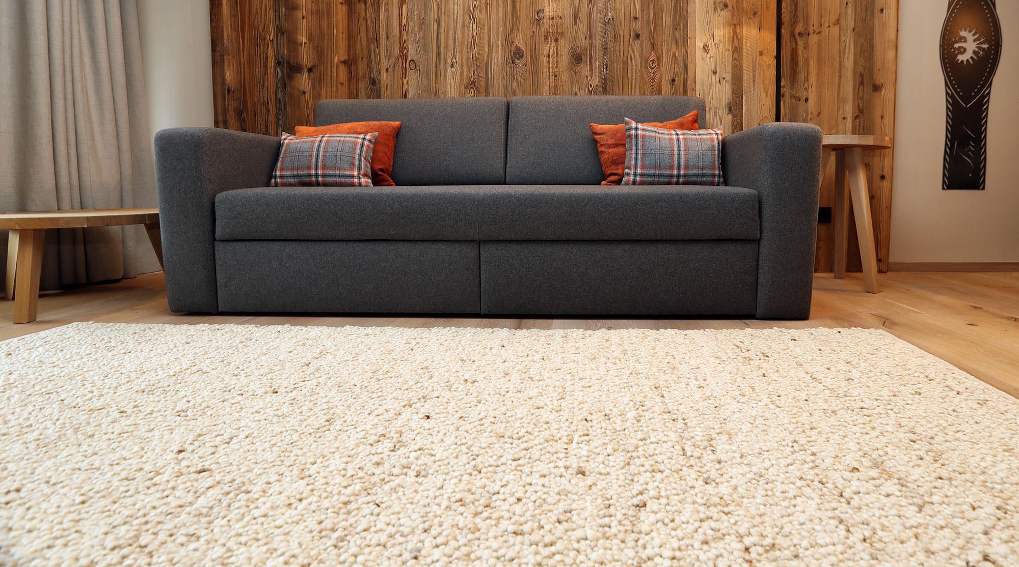 Wohnraum mit Teppich Gerlosstein